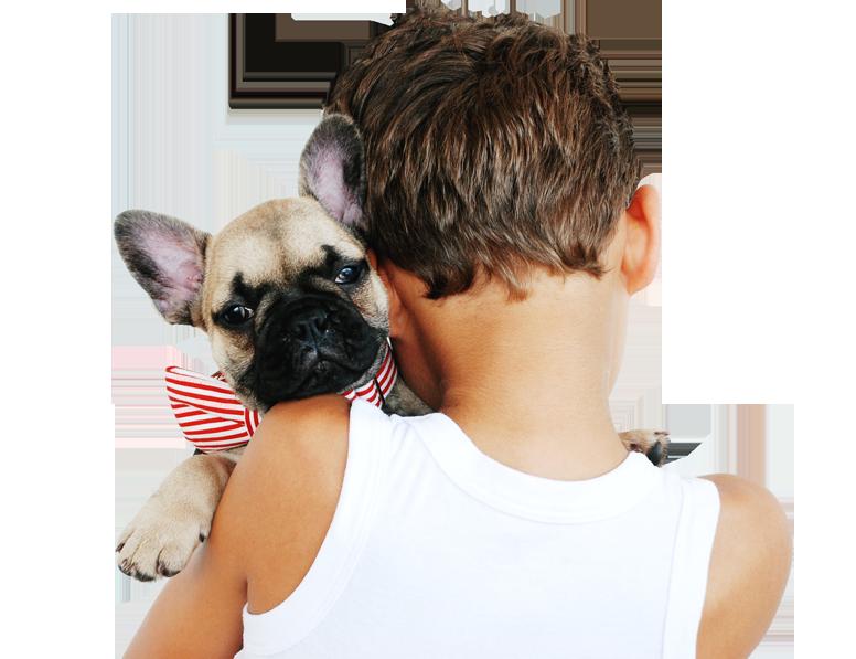 Little boy hugging his dog.
